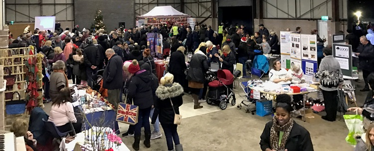 Crowds visiting the Christmas Fair in The Shed
