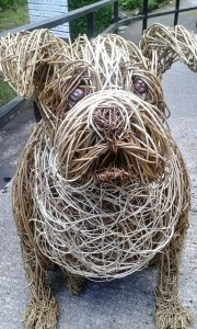 A willow dog by willow artist, Emma Parkins